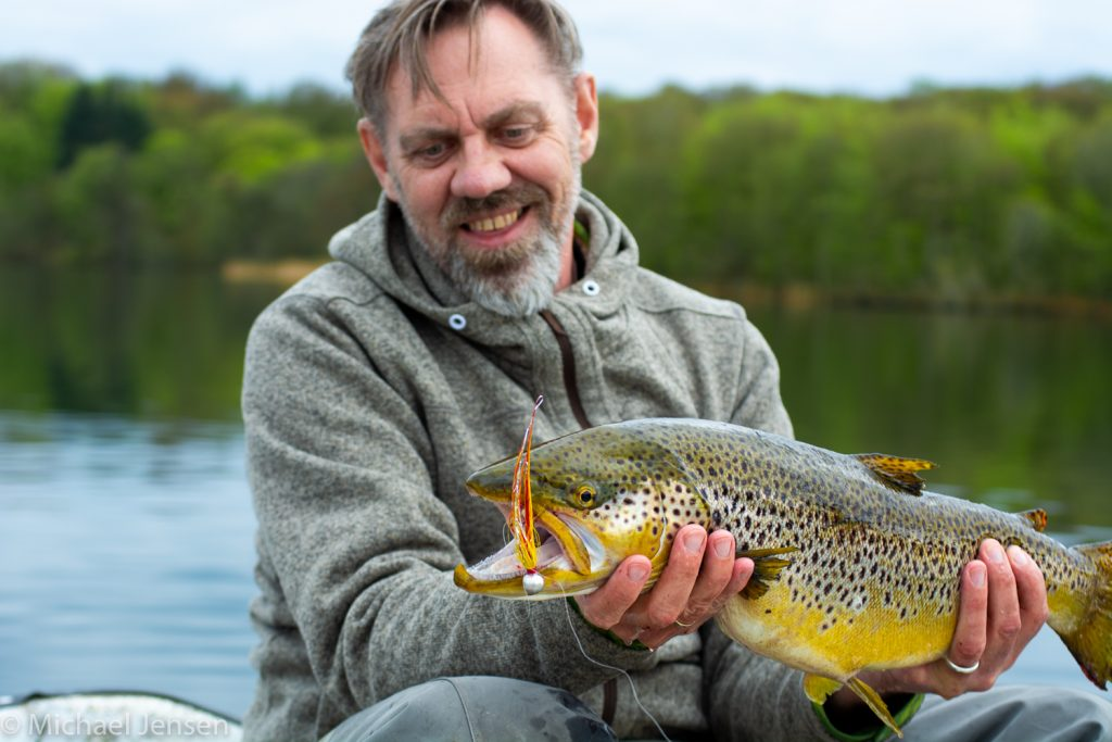 Why you need bucktail jigs Michael with a brown trout caught on a Mickey Finn Jig